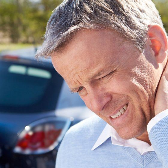 Man suffering from whiplash following a car accident